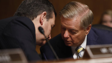 Senator Ted Cruz (left) and Senator Lindsey Graham (right) have a hushed conversation in dramatic scenes minutes before the scheduled vote.