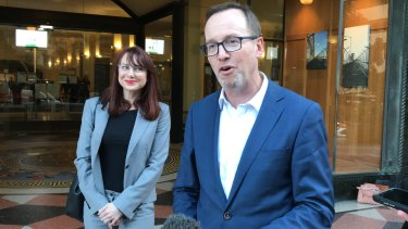 Greens MP David Shoebridge speaks outside court on Friday. Protester Felicity Kitson (left) was found guilty but she will appeal.