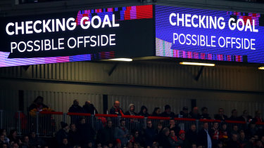 A VAR check takes place during a Premier League game.