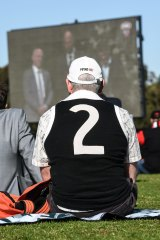 Fans gather at Moorabbin   to watch Danny Frawley's service.