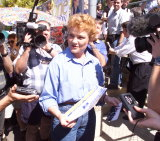 Pauline Hanson collecting the how to vote form for One Nation before going in to vote at Ipswich North Primary School, 1998.