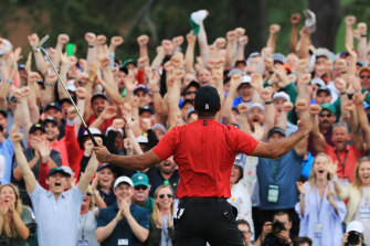 Tiger Woods celebrates with the crowd after sinking his winning putt at Augusta to win the US Masters in April.