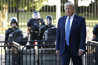 President Donald Trump walks through Lafayette Park to St John's Church, across from the White House in Washington.