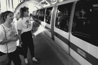 Debbie Meehan (right) with Gillian Burton of Melbourne wait to board the Sydney Monorail on August 21, 1988.