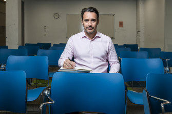 Ben Bonjean, director of English First's Australia operations, sits in an empty classroom at the company's Sydney college, which had just six students enrolled in December.