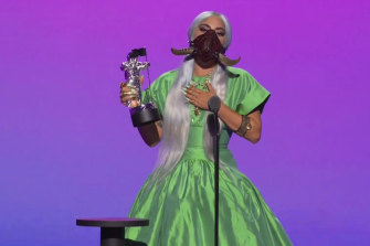 For the Song of the Year award, Lady Gaga wore a gigantic iridescent emerald green shirtdress ballgown from Christopher John Rogers and a matching bejeweled and tusked Lance V. Moore mask.