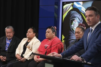 Detective Inspector Tim Day (right) addresses the media with Mr Tuivasa's relatives.