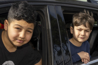 Al-Taqwa College students Khaled and Mohammed Jawad queue outside the school for a COVID-19 test.