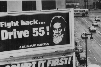 San Francisco, January 1980: The image of Iran's Ayatollah Khomeini is used to encourage motorists to conserve petrol.