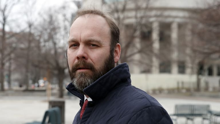 Rick Gates departs federal court in Washington in February.