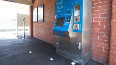 Receipts litter the ground in front of a myki machine in Brunswick.
