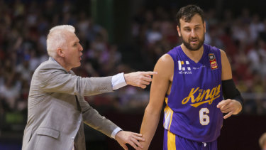 Sideline action: Bogut and coach Andrew Gaze come to terms with the game slipping away.