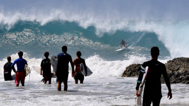 Surfers make the most of large surf at Snapper Rocks on the Gold Coast on Thursday.
