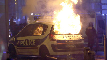 A police car burns after clashes between police and protesters, in Marseille, southern France, on Saturday.