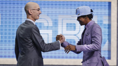 Ja Morant, the No.2 NBA draft pick, is greeted by NBA commissioner Adam Silver after being taken by Memphis.