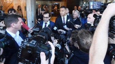 Israel Folau leaves his Fair Work Commission hearing in June.