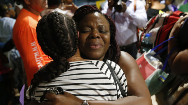 Jasmine Farrinton hugs Roshane Eyma after she was rescued and flown to Nassau after Dorian devastated the Abaco Island, Bahamas.