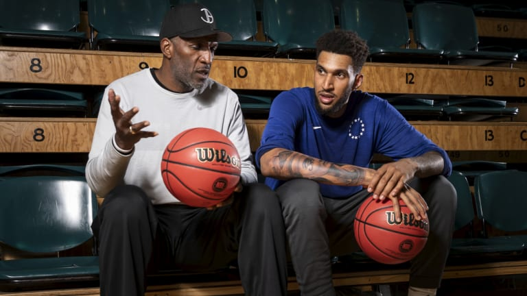 New 76ers player Jonah Bolden with his NBL legend father Bruce Bolden.