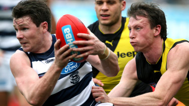 Patrick Dangerfield (left) is tackled by Dylan Grimes.