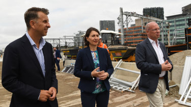Transport Minister Andrew Constance, left, Premier Gladys Berejiklian and Sydney Metro chief executive Jon Lamonte inspect work at Central Station on Monday.