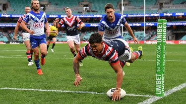 Latrell Mitchell dives over for one of his two tries on Sunday before being overlooked for Origin II.