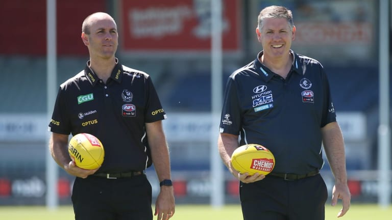 Carlton coach Damien Keeping (right).