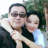 In this 2017 photo provided by his family, Yang Hengjun, left, poses with his family member in Beijing.