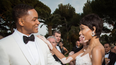"""""""I never would've been able to talk about that while he was alive,"""" Will Smith, pictured with modelWinnie Harlow in France in 2017, said in an interview with GQ magazine about his late father, who physically abused his mother and propelled Smith into a lifetime of people pleasing."""