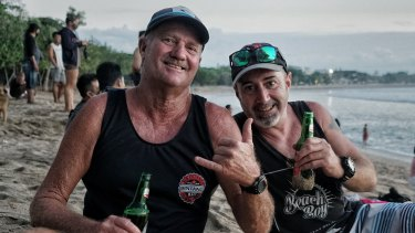 Tim Ryan (R) and Paul Sage (L) at Kuta beach in Bali after it re-opened, waiting for sunset.