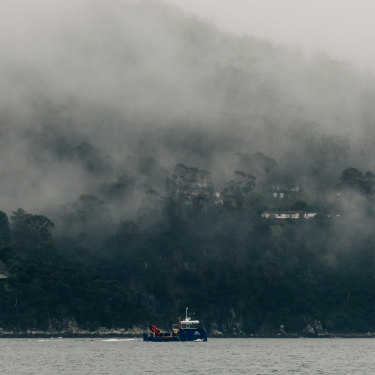 A Huon Aquaculture boat travels up the D'Entrecasteaux Channel, which locals say is polluted by effluent from fish farms.