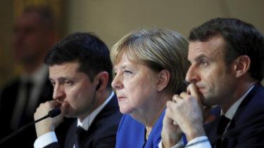 German Chancellor Angela Merkel, centre, with Ukraine's President Volodymyr Zelenskiy, left, and French President Emmanuel Macron in early December.