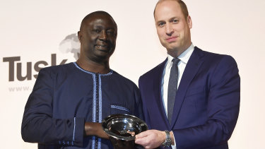 Winner of the 2019 Tusk Award for Conservation in Africa Tomas Diagne poses with Britain's Prince William in London.