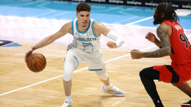 LaMelo Ball surges forward for the Charlotte Hornets against the Toronto Raptors.
