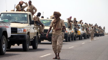 Sudanese forces fighting alongside the Saudi-led coalition in Yemen gather near the outskirts of the western port city of Hodeidah on Tuesday.