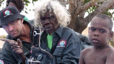 The late Laurie Baymarrwanga, Bentley James and Clint watching dance at Murrungga Island in 2009.