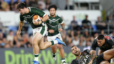 Brandon Smith of the Maori Kiwis breaks free at CBus Super Stadium on the Gold Coast.