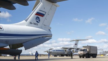 Nine Il-76 cargo planes are loaded at the Chkalovsky military airport in Moscow as Russia prepares to send medical personnel and supplies to Italy to help the country's efforts against the coronavirus.