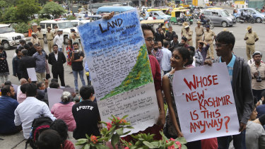 Indian activists protest the Kashmir decree in Bangalore, India.