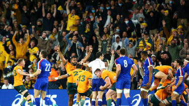 The Wallabies celebrate victory over France.