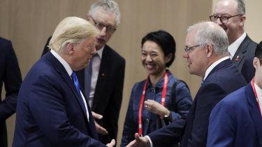 US President Donald Trump greets Prime Minister Scott Morrison in Osaka on Saturday.