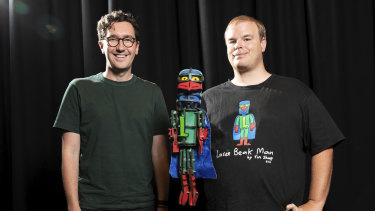 David Morton (left), artistic director of Dead Puppet Society, puppet Laser Beak Man and Tim Sharp, who created Laser Beak Man.