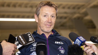 Decisions to make: Melbourne Storm coach Craig Bellamy speaks to the media at Melbourne Airport.
