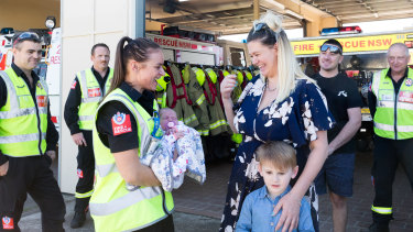Ms Korn, her four-year-old son Dylan and her new baby Arley are reunited with firefighters who assisted her delivery