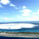 The sea close to the shore of Fangataufa Atoll turns white following the detonation of an underground French nuclear test in 1995.