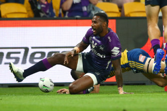 Suliasi Vunivalu crosses for a Storm try at Suncorp Stadium.