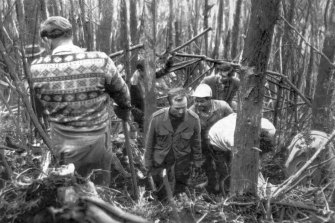 Police and civilians force a passage through the matted undergrowth towards the Southern Cloud.