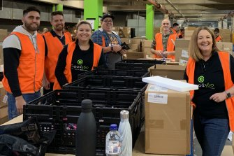 Good360 founder Alison Covington and staff. The organisation redistributes surplus stock from retailers and suppliers to people in need.