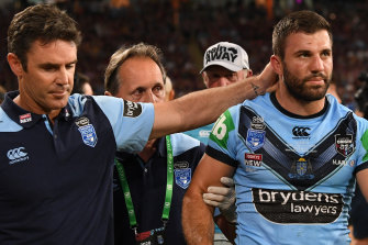 Brad Fittler consoles a heavily concussed James Tedesco.