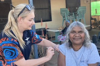 Cheryl Stewart receives her first dose of Pfizer during a RFDS visit to the remote South Australian town of Oodnadatta. Just 16 per cent of Indigenous Australians are fully vaccinated.