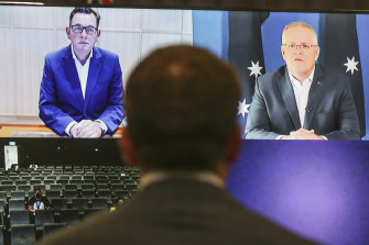 Premier Daniel Andrews and Prime Minister Scott Morrison address the media in a virtual press conference seen from Parliament House in Canberra on Saturday.